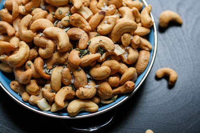Cashew nuts in a blue ceramic bowl